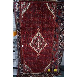 100% wool Iranian Hosseinabad area carpet with center medallion, red background, highlights of royal