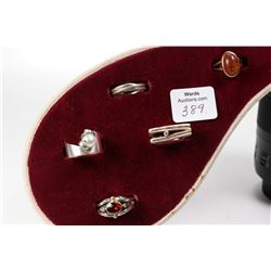Tray lot of rings including sterling silver and diamond, tested 10kt gold and amber, sterling silver