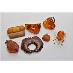 Selection of amber jewellery including brooches, spider pin, ring, pendants etc. plus a petrified wo