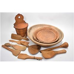 Selection of primitive kitchenware including three graduated wooden bowls, plus a selection of spoon