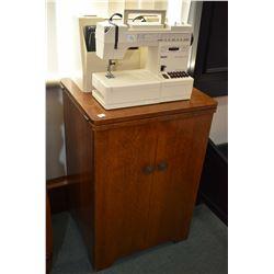 Antique oak sewing machine cabinet plus a a Pfaff Hobbymatic 947 Sewing machine