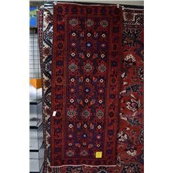 100% wool Iranian Ferdos area carpet with overall geometric design including wide inside border in s