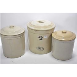 Three stoneware crocks with lids including Medalta two gallon and two unmarked one gallon crocks