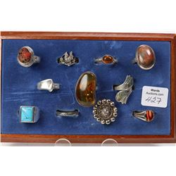 Eleven vintage sterling rings including amber, turquoise, abalone shell, polish stone etc.