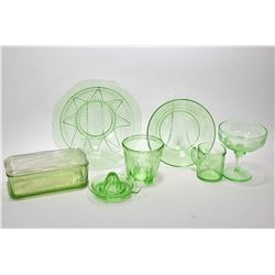 Selection of vintage uranium glass including two measuring cups, two serving bowls, lidded refrigera