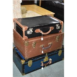 Three vintage suitcases including steamer style