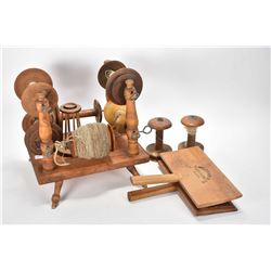Selection of wool accessories including wool spool stand, plus two empty spools and a pair of carder