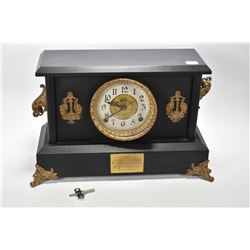 Antique simulated slate chiming mantle clock with attached ormolu style decoration manufactured by t