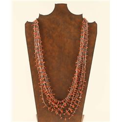 Eight Strand Coral & Liquid Silver Beaded