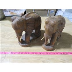 TWO CARVED WOODEN ELEPHANTS