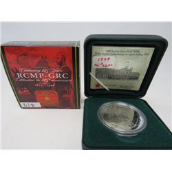 1998 Proof silver dollar 125th anniversary of the RCMP in case of issue.