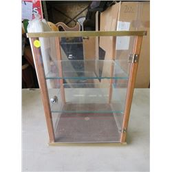 """SHOWCASE WITH GLASS SHELVES ( 17"""" TALL X 12"""" LONG X 12"""" WIDE) *SMALL GLASS CHIP*"""