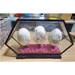 LOT OF DECORATIVE EGGS IN DISPLAY CASE