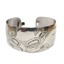 NW Coast Native carved Silver Bracelet with clasp WOLF SEAL scene