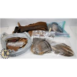 BOX OF LEATHER PIECES, BUCKLES, FEATHERS AND MORE.