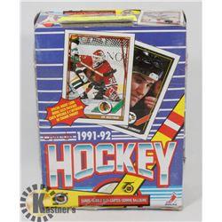 BOX OF 1991-92 OPEECHEE NHL CARD PACKS.