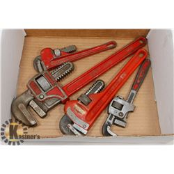 BOX W/ 4 RIDGID AND COMPANION PIPE WRENCHES.