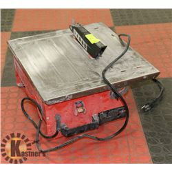 """7"""" TABLE TOP WET TILE SAW."""