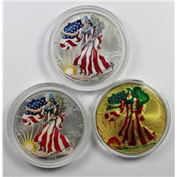 THREE COLORIZED AMERICAN SILVER EAGLES