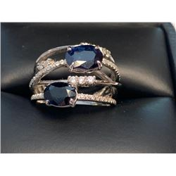 LADIES MULTI STONE 14KT WHITE GOLD WITH 3.18CT SOLITAIRENATURAL SAPPHIRE AND DIAMONDS. SIZE 5.5. CER