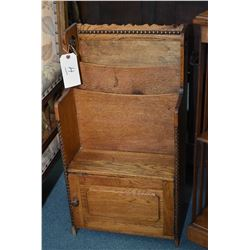 "Antique oak canterbury with two magazine slots and book shelf and small cupboard underneath, 30"" in"