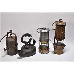 Four antique lanterns including two different The Wolf Safety Lamps etc.