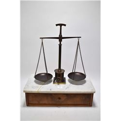 Antique balance scale on single drawer marble topped base plus a selection of graduated weights