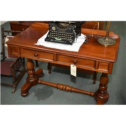 Antique mahogany two drawer writing desk with bun feet, appears to be original finish