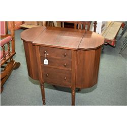 Mid 20th century knitting/sewing cabinet with three drawers and flip up side storage access made by