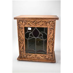 Antique quarter cut oak single door cabinet fitted with Nouveau leaded glass panel in carved door fr