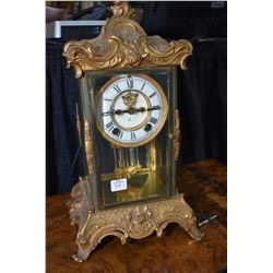 Gilded brass mantle clock made by The Ansonia Clock Company, New York with porcelain dial, Roman num
