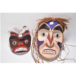"Two hand carved and hand painted masks marked on verso ""Art Cootes, Ucluelet B.C"" 12"" and 7"" in heig"