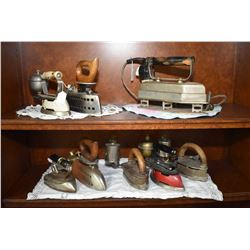 Eight assorted antique irons, each are either gas or electric operated including Imperial Self-heati