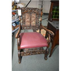 Pair of antique, matching, heavily carved Jaccobean open arm side chairs with angel motif back and f