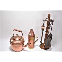 Two pieces of antique copper and brass including kettle and carafe and a barley twist companion set