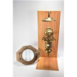 Antique brass nautical port hole and a brass full gimbal mount ship's oil lantern with heat diffuser