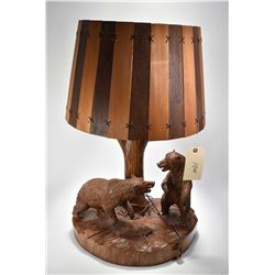 Hand carved Black Forest style table with tree trunk lamp support and pair of carved fighting bears