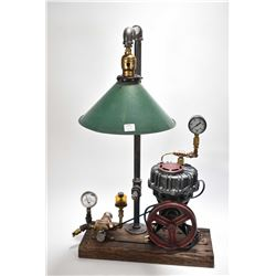 "Speedy steam punk table lamp. This light was created using a vintage ""Speedy"" air compressor believe"