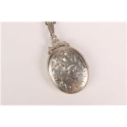 Birks sterling silver neck chain and chased sterling locket pendant