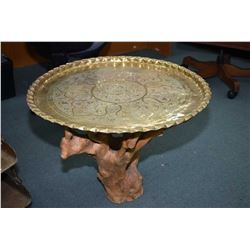 "Occasional table with knotted burl base and a 31"" diameter hand chased brass top"