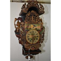 Antique cast and wood figural wall clock with chiming weight driven movement, painted face and dial