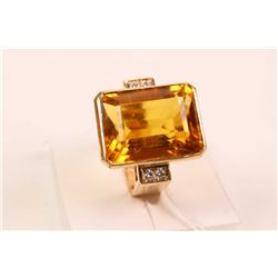 14kt yellow gold dinner ring set with faux 15.00ct center gemstone and .12cts of accent diamonds. Re