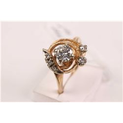 Ladies 14kt yellow and white gold and diamond ring set with .40ct center brilliant cut diamond and 0