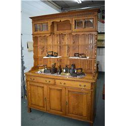 Antique quarter cut oak Welsh dresser with two bevelled glass panelled top display doors, multiple d