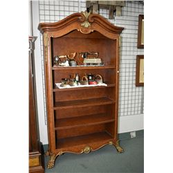 Tall modern shelving unit with decorative scroll top and heavy paw feet