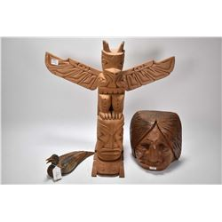 """Hand carved 20"""" totem pole by artist Fred Corhill, a carved wooden bust by Marvin Baker, Squamish an"""