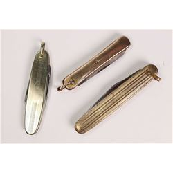 Three antique gold filled pocket watch pen knife fobs including one set with small diamond gemstone