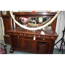 Antique flame mahogany Empire style, multi drawer sideboard with three door storage base, glass pull