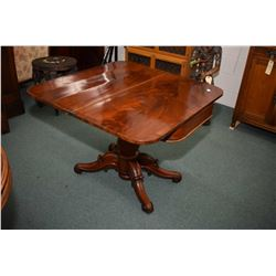 Flamed mahogany antique center pedestal fold over parlour table