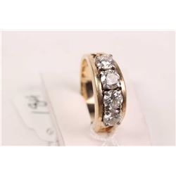 Ladies 14kt yellow and white gold four stone diamond eternity ring. Set with 1.00ct of brilliant cut
